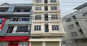 5 FLOOR BUILDING ALONG NR1